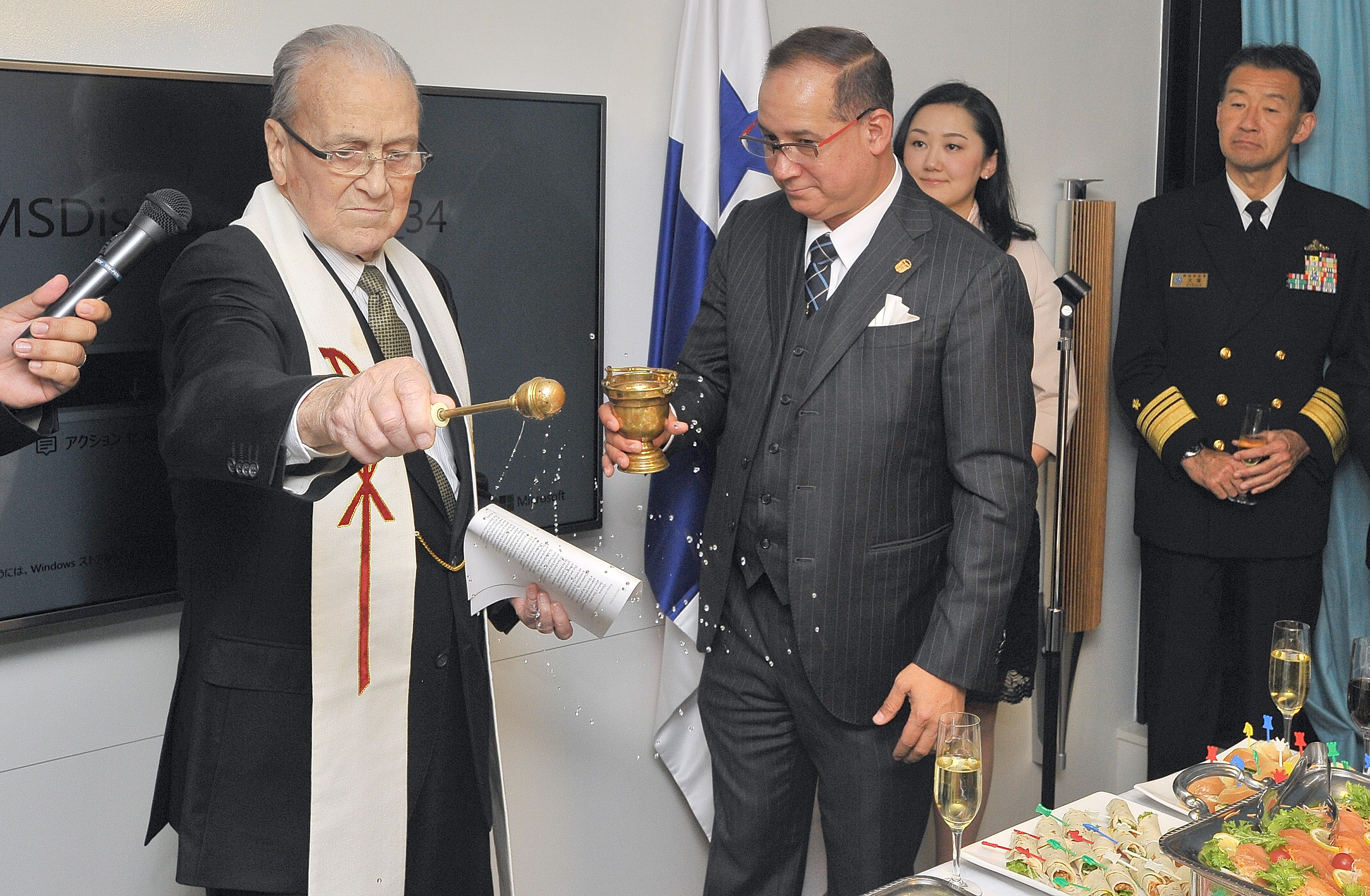 The Farther Arturo Martin, blessing the Holy Water for the new offices